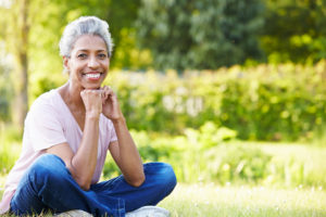 Living With Metastatic Disease Photo Of Woman Sitting On Grass